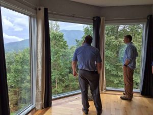 Photo Courtesy of Dima Holmes - Wintergreen Real Estate Company : Will Fenton (left) shows Ben Holmes of Nellysford one of the spectacular views looking toward the mountains from one of the bedrooms. Wednesday - August 17, 2006