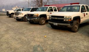 Virginia Department of Forestry trucks are lined up at the Command Post on Eades Lane Thanksgiving morning with smoke hanging in the air. The battle again a wildfire that started last weekend continues on Thanksgiving day. November 24, 2016.