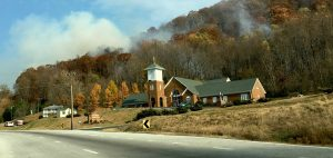 Photo By John Mckeithen : Fire continus burning on Peebles Mountain just behind St Mary's Catholic Church just north of Lovingston, Virginia Thursday morning November 24, 2016.  A fire line previously set at Buzzard's Rock by forestry crews was jumped overnight.