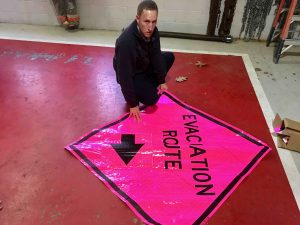 Photo By Tommy Stafford : BRL Digital Media Director : Chief Curtis Sheets of Wintergreen Fire & Rescue shows off one of the portable evacuation route signs that would be used in the even of a wildfire emergency on the mountain. Wednesday - December 7, 2016