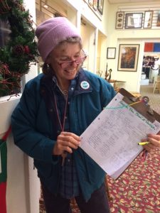 Photo courtesy of Victoria Jenkins : Victoria Jenkins holds up a clipboard showing some of the 300+ signatures she got this past Saturday during the INdoor Market held at the Rockfish Valley Community Center in Greenfield / Afton.