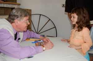 Photo By Tommy Stafford : Earl Hamner, Jr. chats it up with one of his youngest fans during a visit back to his hometown of Schuyler, Virginia 10 years ago in March of 2007.