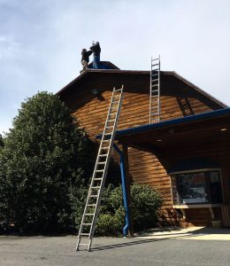 Way up there on the roof at The Ski Barn, Tommy & Clayton put the finishing touches on the latest WeatherNow station in Beech Grove : Friday - March 17, 2017.