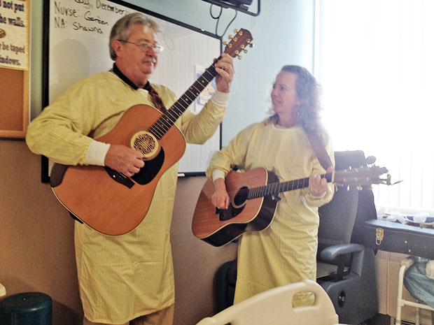 Bernie Coveney and Andrea Marshall play and sing at the hospital.