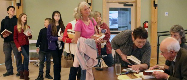 Wendell Barry autographing books at the Eco-Village Friday afternoon.
