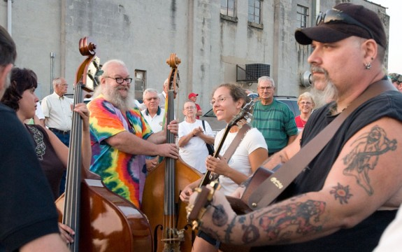 Musicians gather and play on Locust Street on a Friday night.