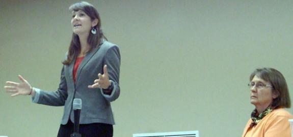 Lauren Harmon LeRoy speaks as Rebecca Howell awaits in the School Board race.