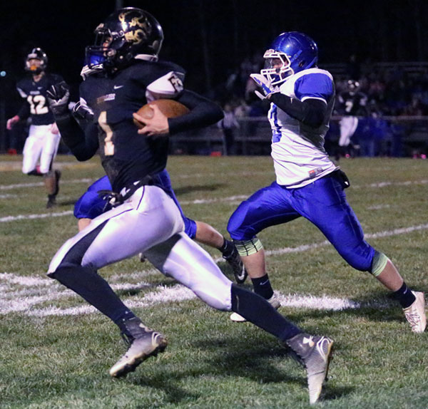 Buffalo Quarterback Brady Underwood turns a busted pass play into yardage.