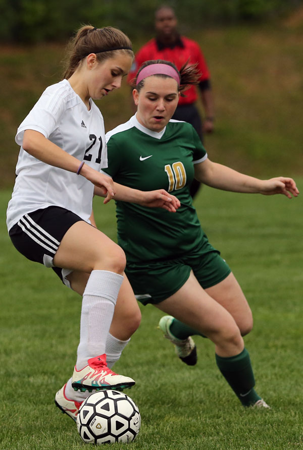 Fighting for the ball in the girls' game.