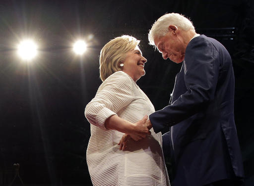 Democratic presidential candidate Hillary Clinton, second from right, greets her husband, former president Bill Clinton during a presidential primary election night rally, Tuesday, June 7, 2016, in New York. (AP Photo/Julie Jacobson)