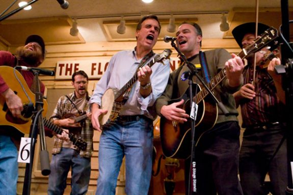 Mark Warner and Tim Kaine on stage at The Friday Night Jamboree with The Jugbusters. IPhotos by Doug Thompson)
