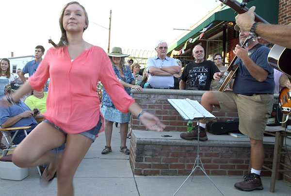One of the dancing regulars on South Locust Street Friday evening.