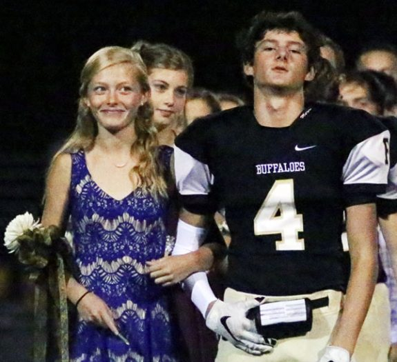 Two members of the high school homecoming court waiting to be introduced to the game audience.