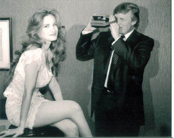 Real estate tycoon Donald Trump takes a photo of Bridget Marks during Playboy magazine's 49th Anniversary Playmate Search at a New York hotel. (Ted Blackbrow/Daily Mail/REX/Shutterstock)