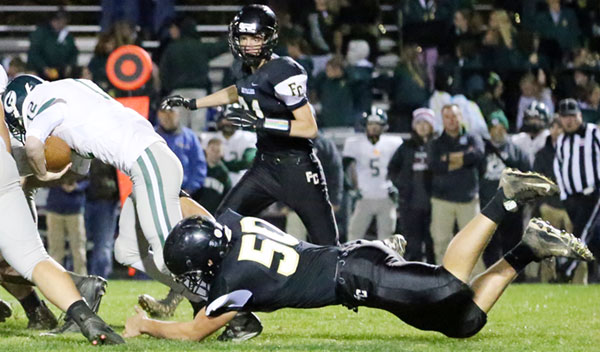 Cory Voss tackles a Glenvar runner and slows down a Highlander drive.