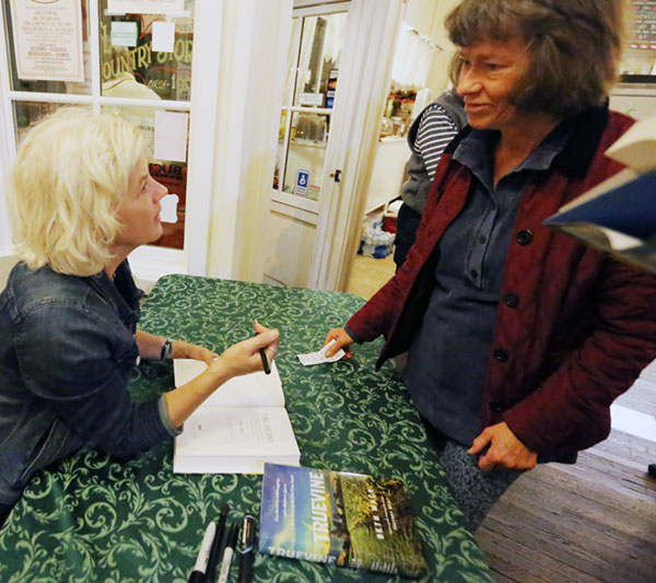 Roanoke author Beth Macy autographs copies of her latest book, Truevine.