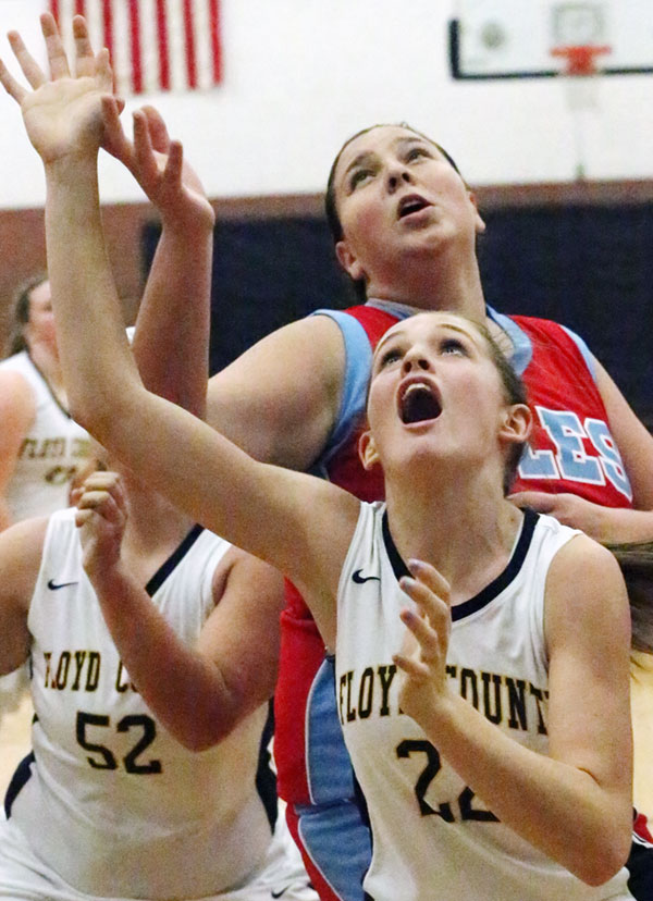 Brooklyn Hall and Emma Nichols focus on a rebound.