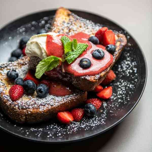 French Toast topped with homemade strawberry jam and mascarpone cheese.