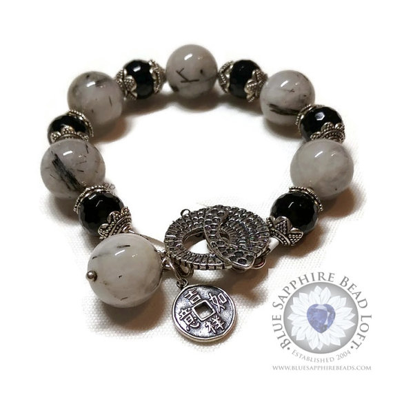 Black Onyx and Rutilated Quartz Bracelet