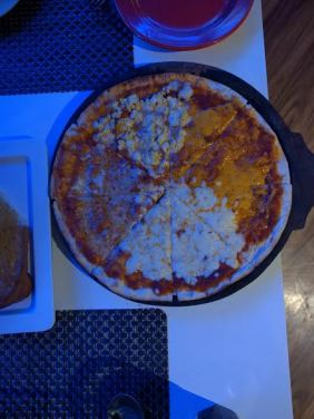 Four cheese pizza is a must-try