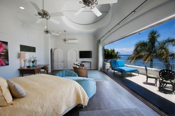 Blue Sky Villa master bedroom with 25 foot deck with ocean views