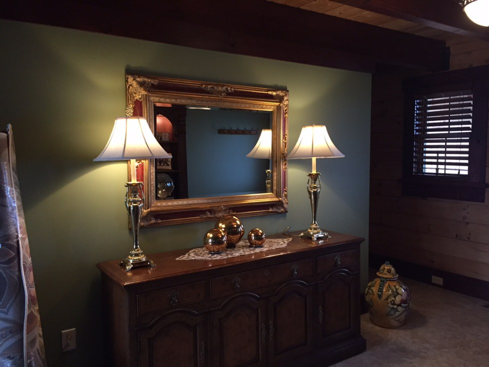 """AFTER: I chose Benjamin Moore's """"Aventurine"""" as the green for the foyer and kitchen areas. Now it feels warm and welcoming."""