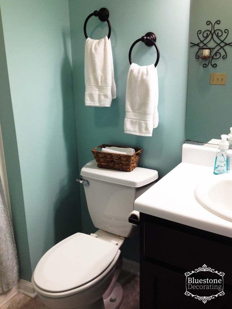 """Changing the paint color from the gray to Sherwin Williams """"Watery"""" gave this bathroom a spa-like feel. SW 6478"""