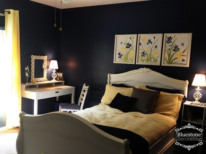 Navy blue bedroom with yellow and white accent colors by Crystal Ortiz of Bluestone Interiors