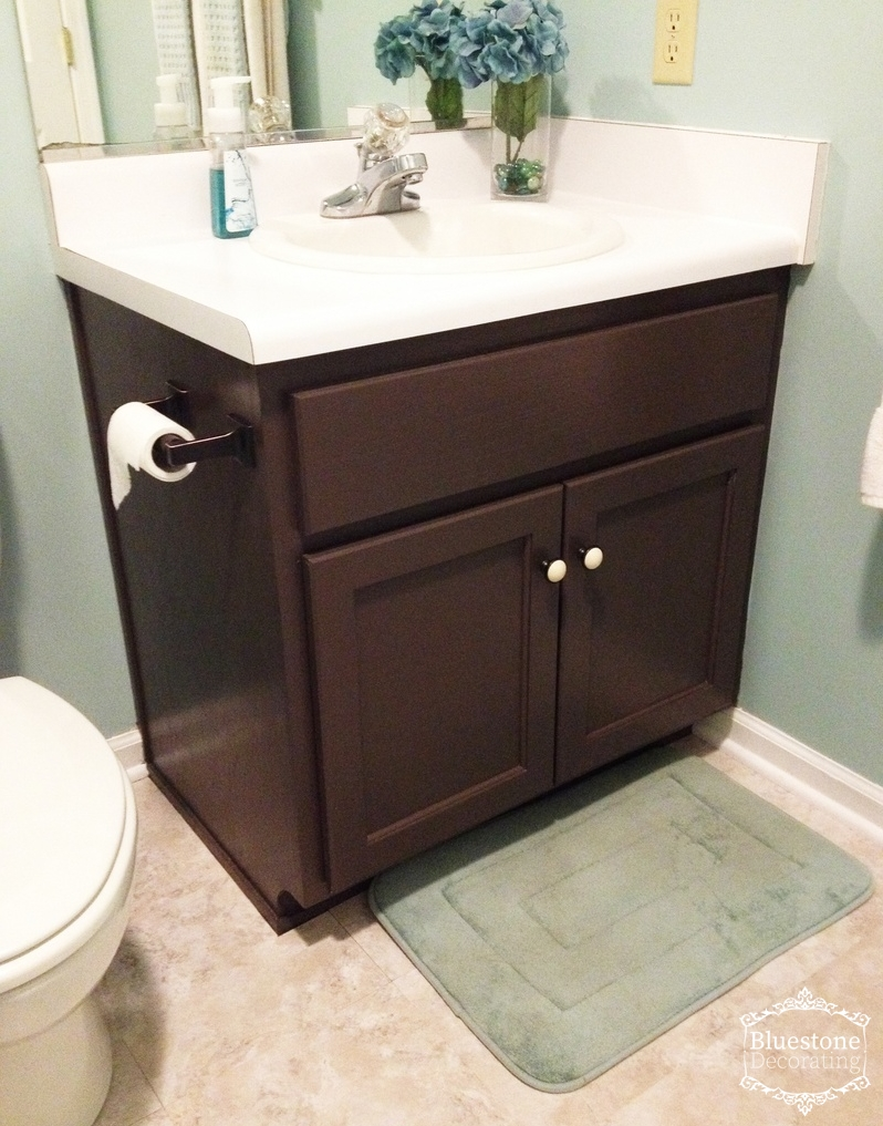 """Same cabinet, painted with """"Labrador"""" from Lowe's and changing the hardware from brass knobs to a new set."""