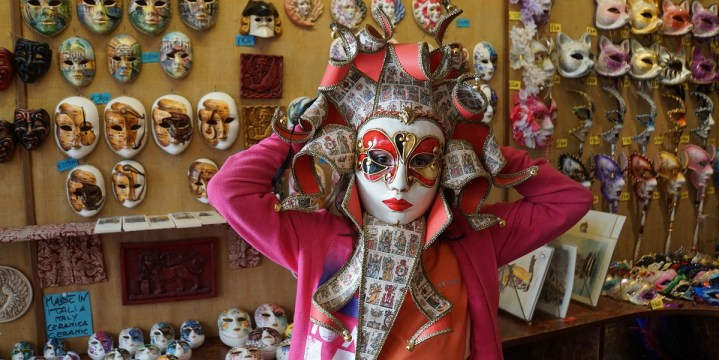 Claire tries on an authentic Venetian mask
