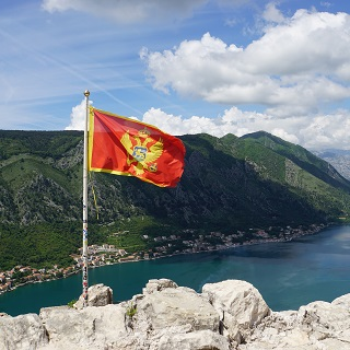 The flag of Montenegro flies 1200 metres above Kotor