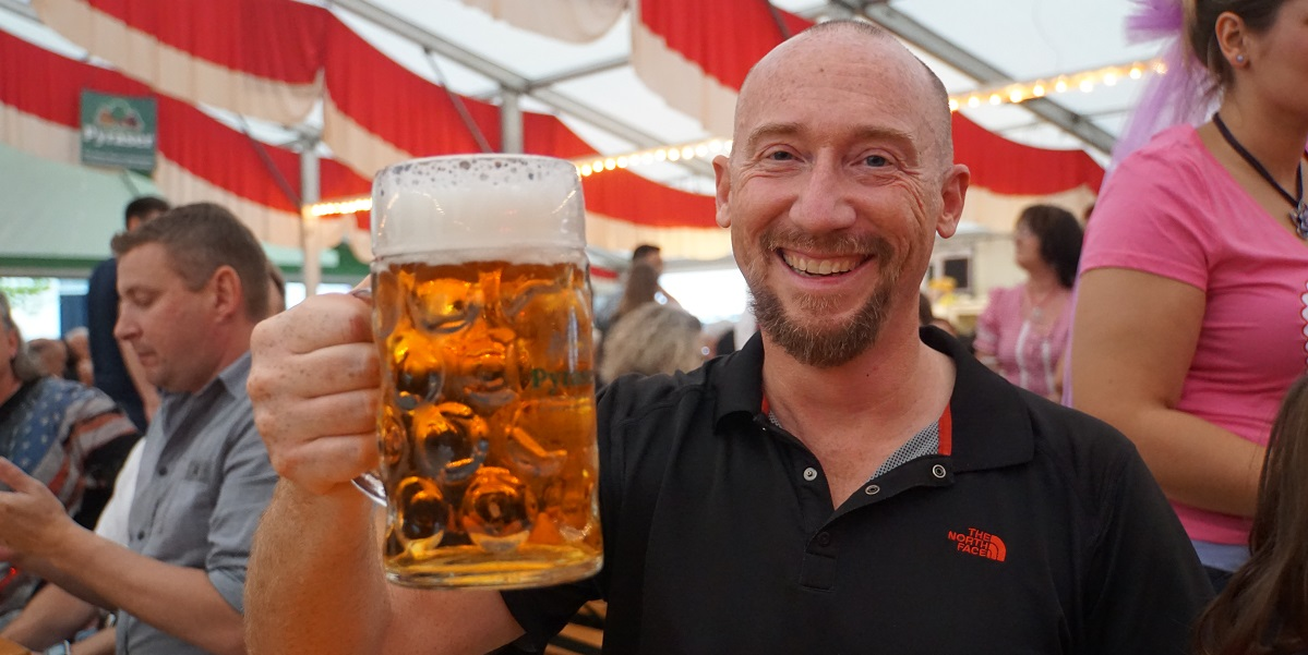 Al drinks beer from a one litre mug