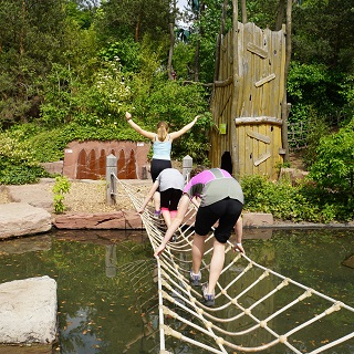 Crossing the rope bridge in the Playmobil Funpark