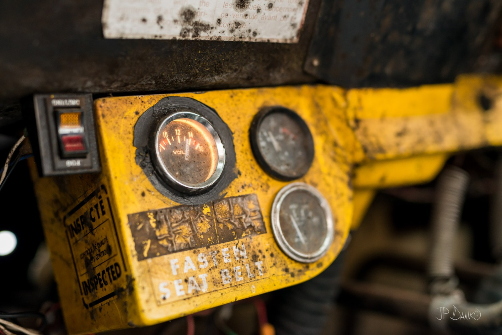 Indicator dials on dashboard of old vintage snow grooming machine