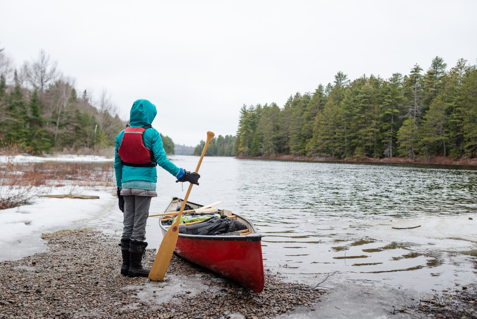 Girl Paddle Spring Red Canoe Trip Backcountry Wilderness Snow