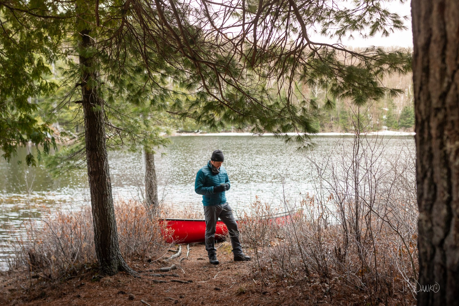 Man Holding Morning Coffee Spring Red Canoe Trip Backcountry Wil