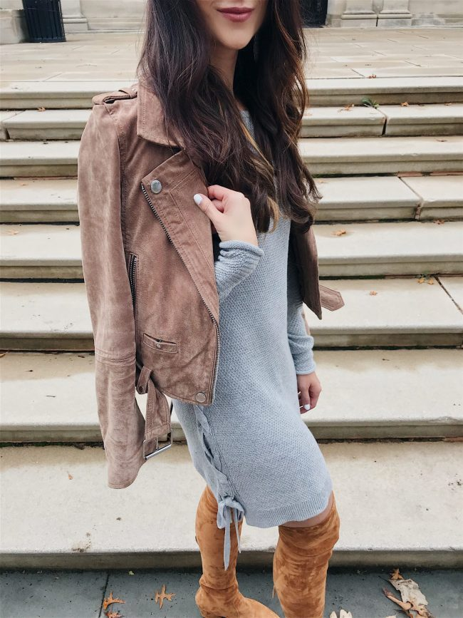 blogger Anna Monteiro of blushing rose style wearing suede moto jacket with grey sweater dress and cognac over the knee boots in tunic top styled 3 ways
