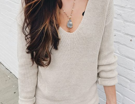 blogger Anna Monteiro wearing cozy fall sweaters and statement necklace