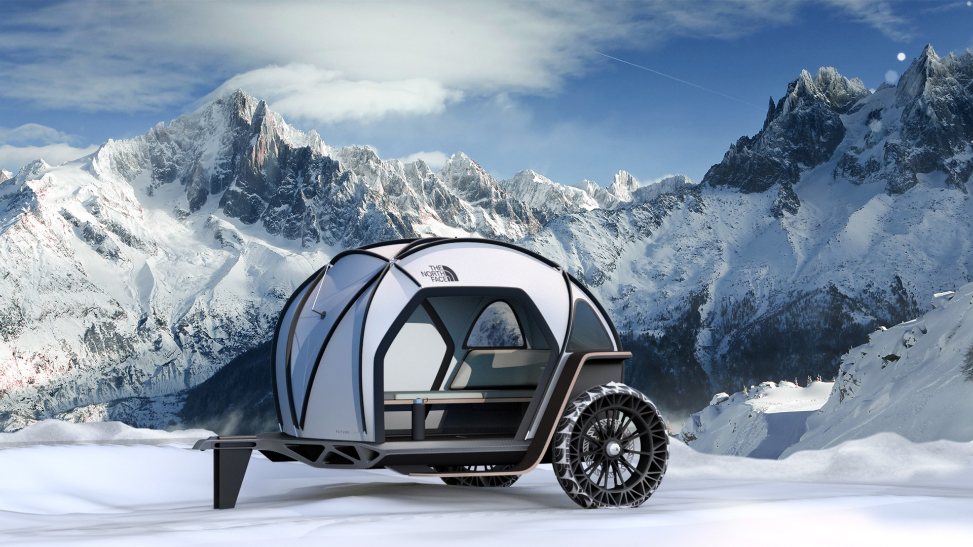 north face camper in snowy mountains
