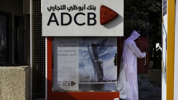 An Emirati man exits after using an Abu Dhabi Commercial Bank PJSC (ADCB) bank automated teller machine (ATM) in Dubai, United Arab Emirates, on Tuesday, Sept. 4, 2018. Abu Dhabi is engineering a second bank merger in its latest attempt to stay competitive in the era of lower oil prices.