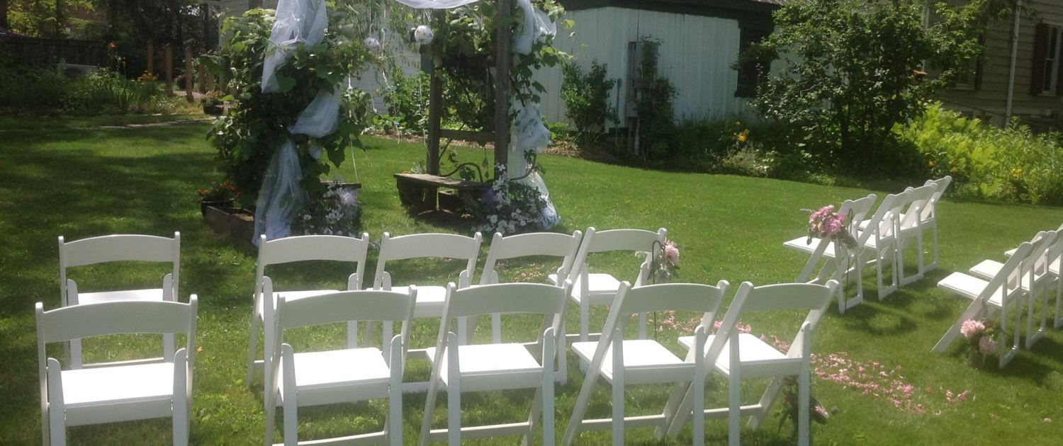 Chairs and chuppah set up in outside