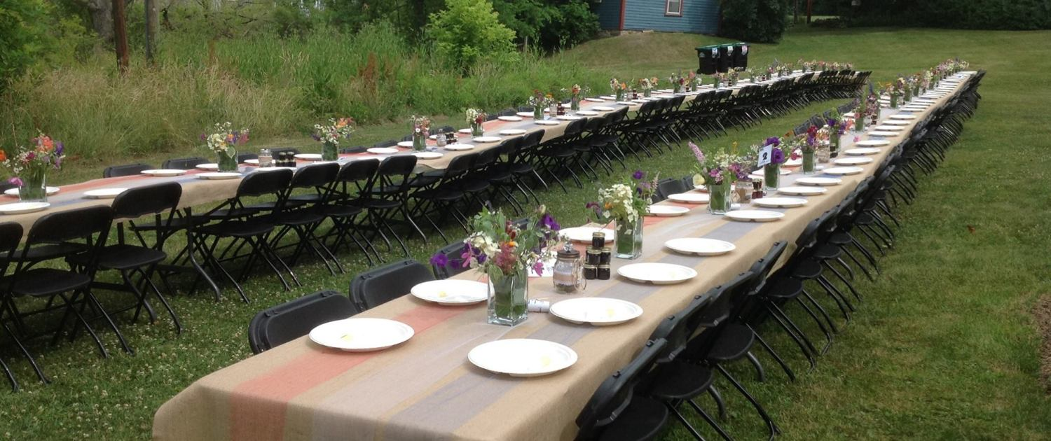Two long tables with place settings