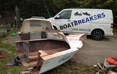 The Issues of Boat Disposal - A Small Fibreglass/Wood Boat being cut up