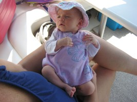 baby with sun hat on boat