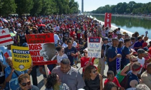 People arrive at the National Mall to celebrate the 50th anniversary of the March on Washington and Dr. Martin Luther King, Jr.'s 'I have a Dream' speech on the National Mall on August 24, 2013 in Washington, DC. A commemorative. Via NBC 11 Atlanta.