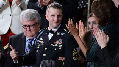 US Army Ranger Cory Remsburg, wounded in Afghanistan, with First Lady Michelle Obama. Photo: AFP