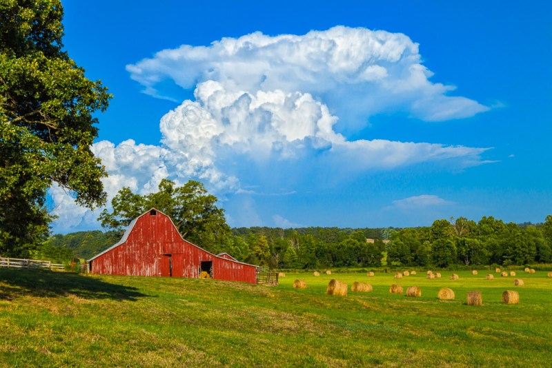 10181. Hay bales, barns, and thunderstorm cloud,Fayetteville, Arkansas
