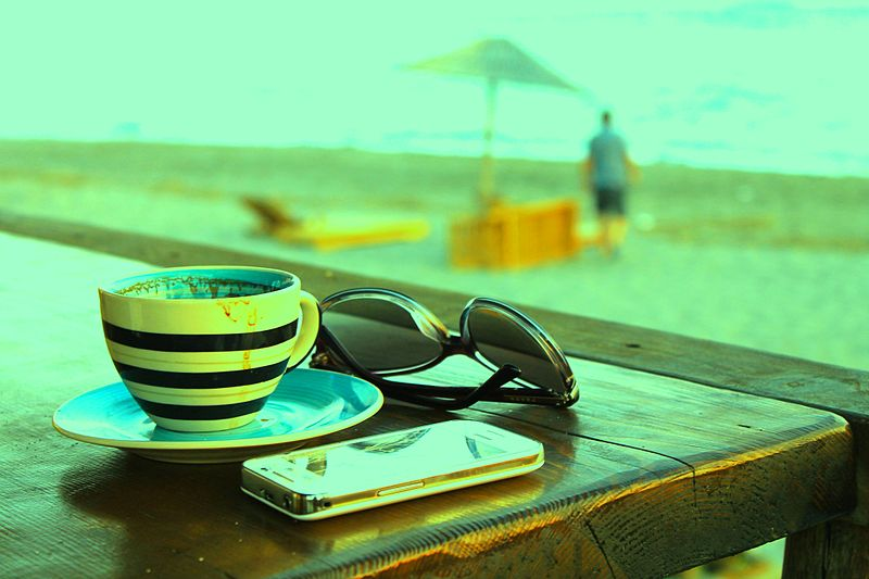 Beach photo with phone, coffee and sunglasses
