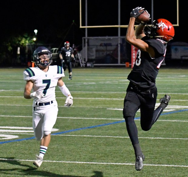Fairview wide receiver Grant Page, right, ...