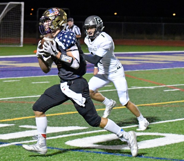 Holy Family wide receiver Ben Nappe, ...